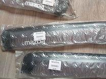 Продам комплект дефлекторов на Mazda Demio